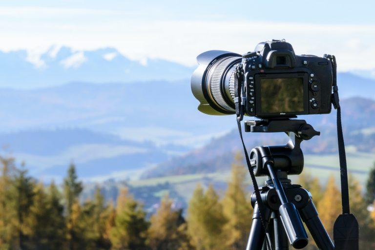 black-dslr-camera-mounted-on-black-tripod-212372